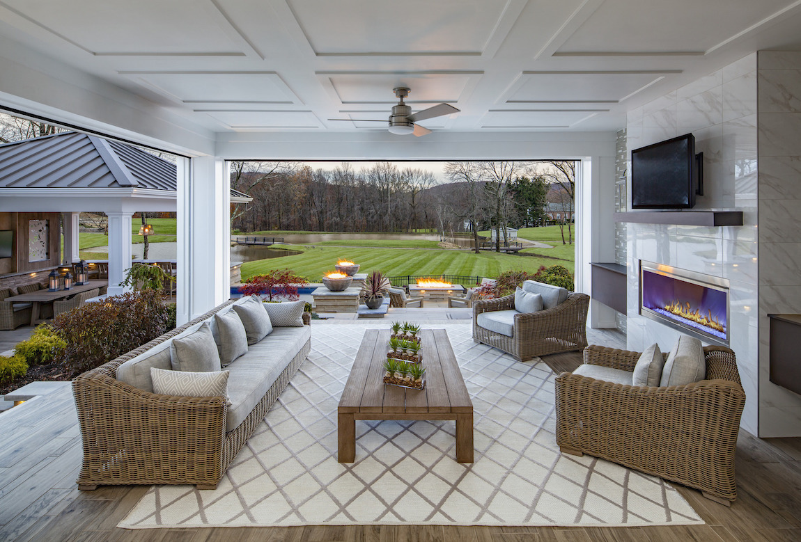 Outdoor room featuring modern fireplace