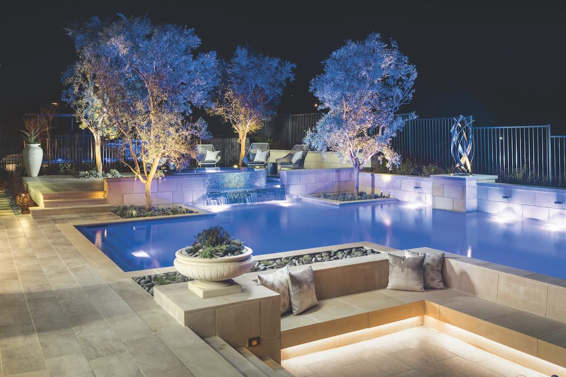 Backyard with illuminated trees and decorations