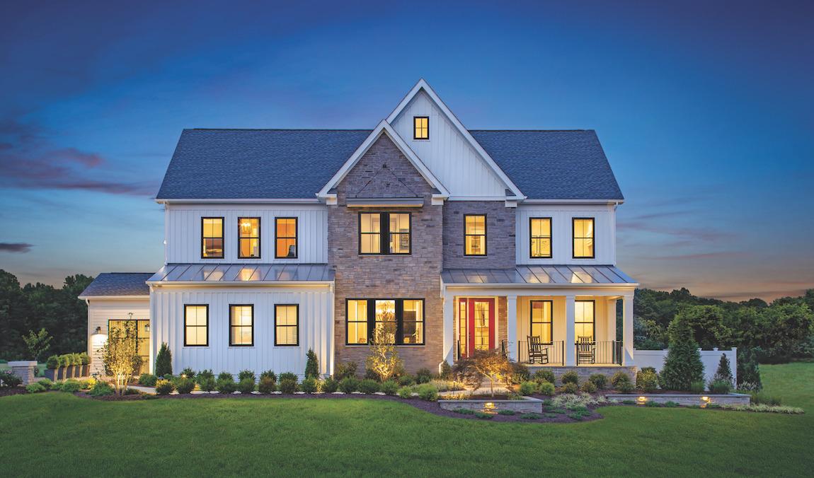 Well-lit modern farmhouse front exterior