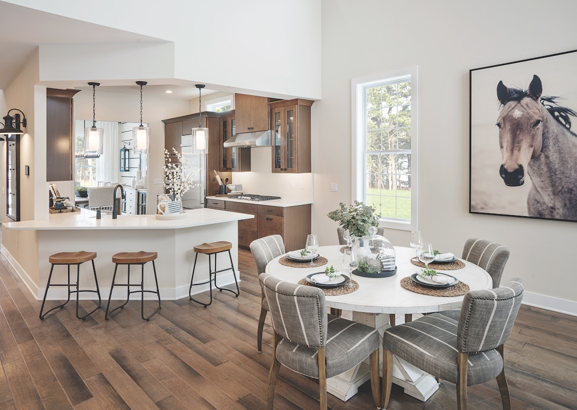 Wooden floor with white round breakfast dining area.