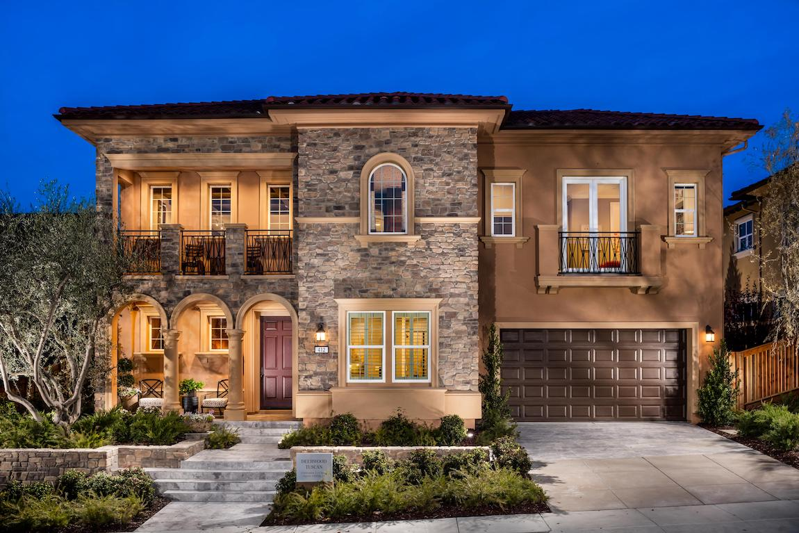 Home with Spanish influence and stone brown exterior.