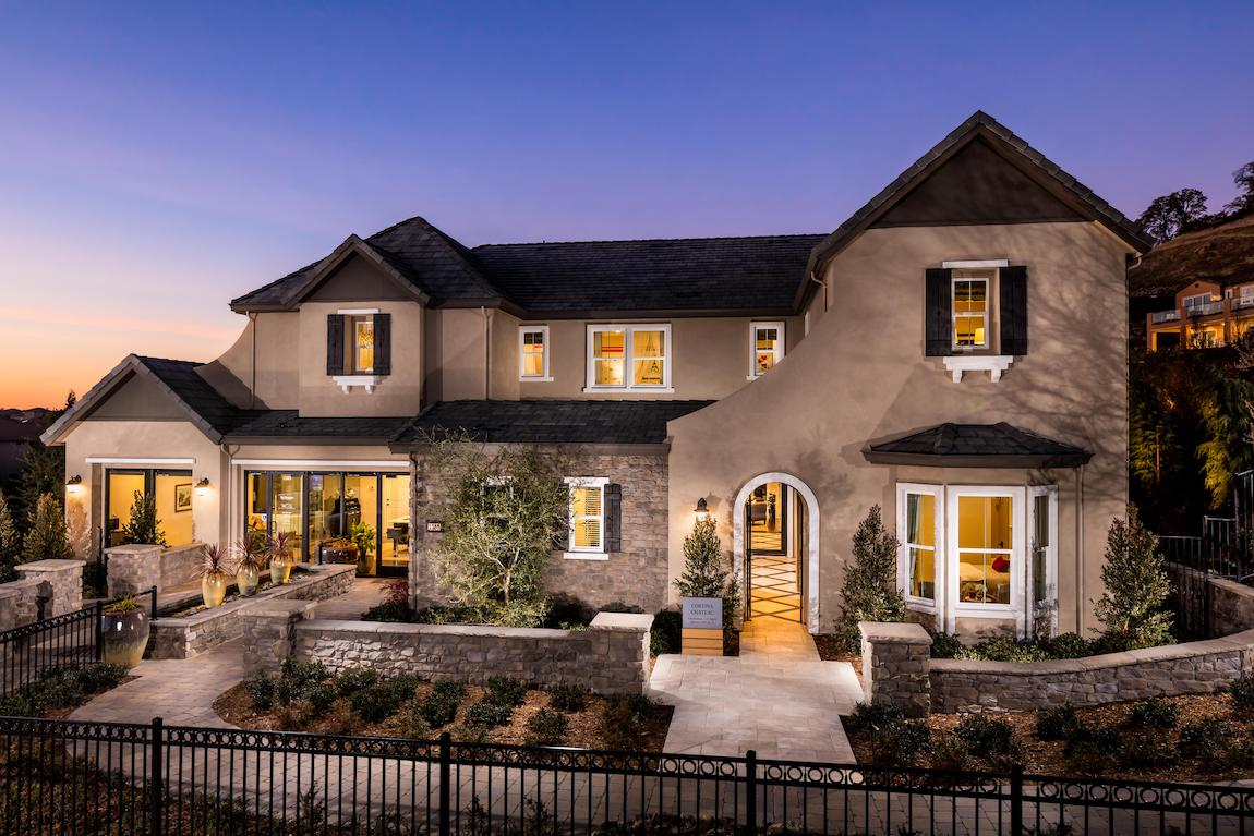 Home with multiple entrances and white framed windows.