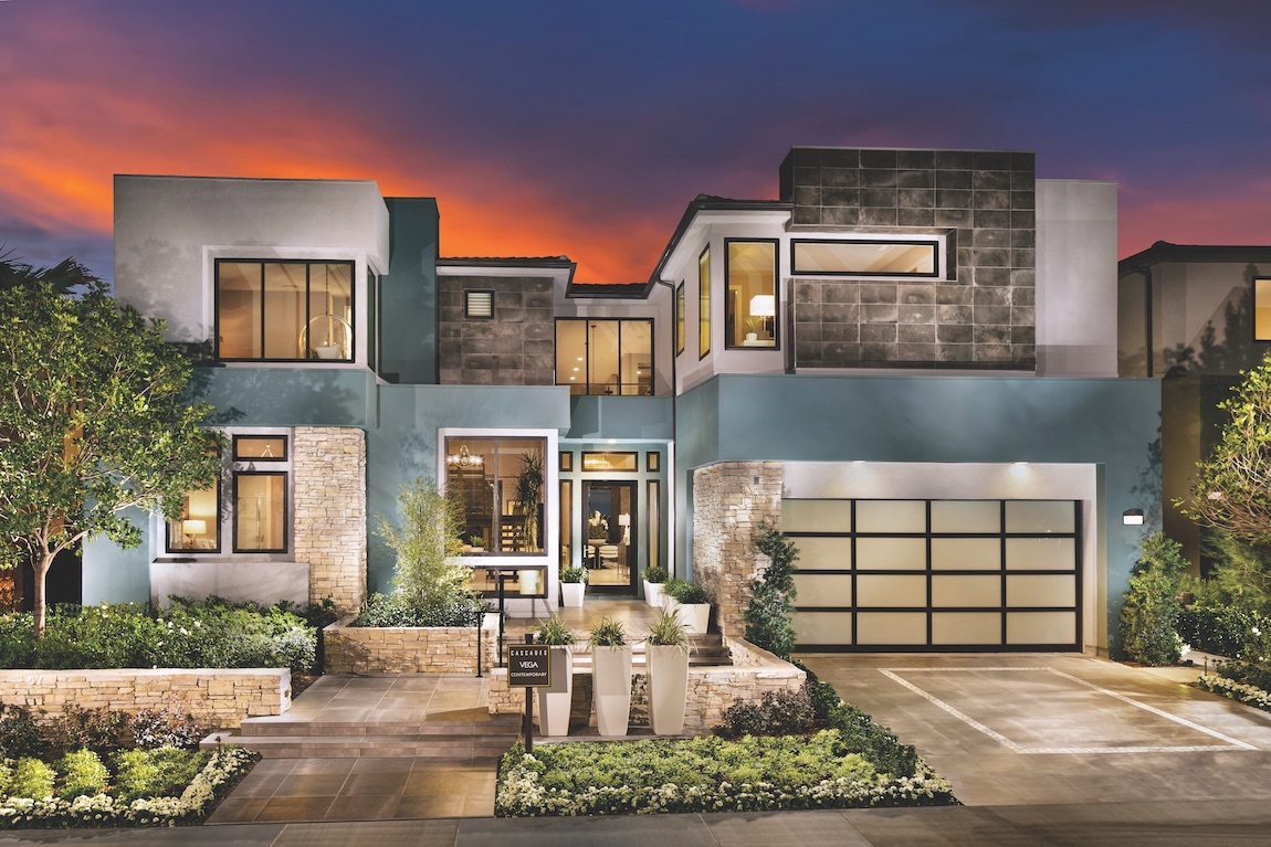 Cubed architectural home design with natural lighting and stone facade.
