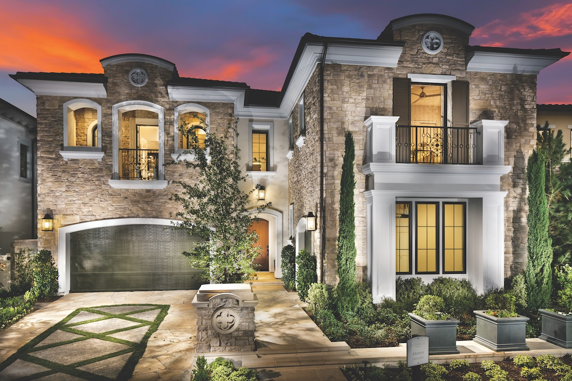 Large two-story home with balcony and rectangular windows.