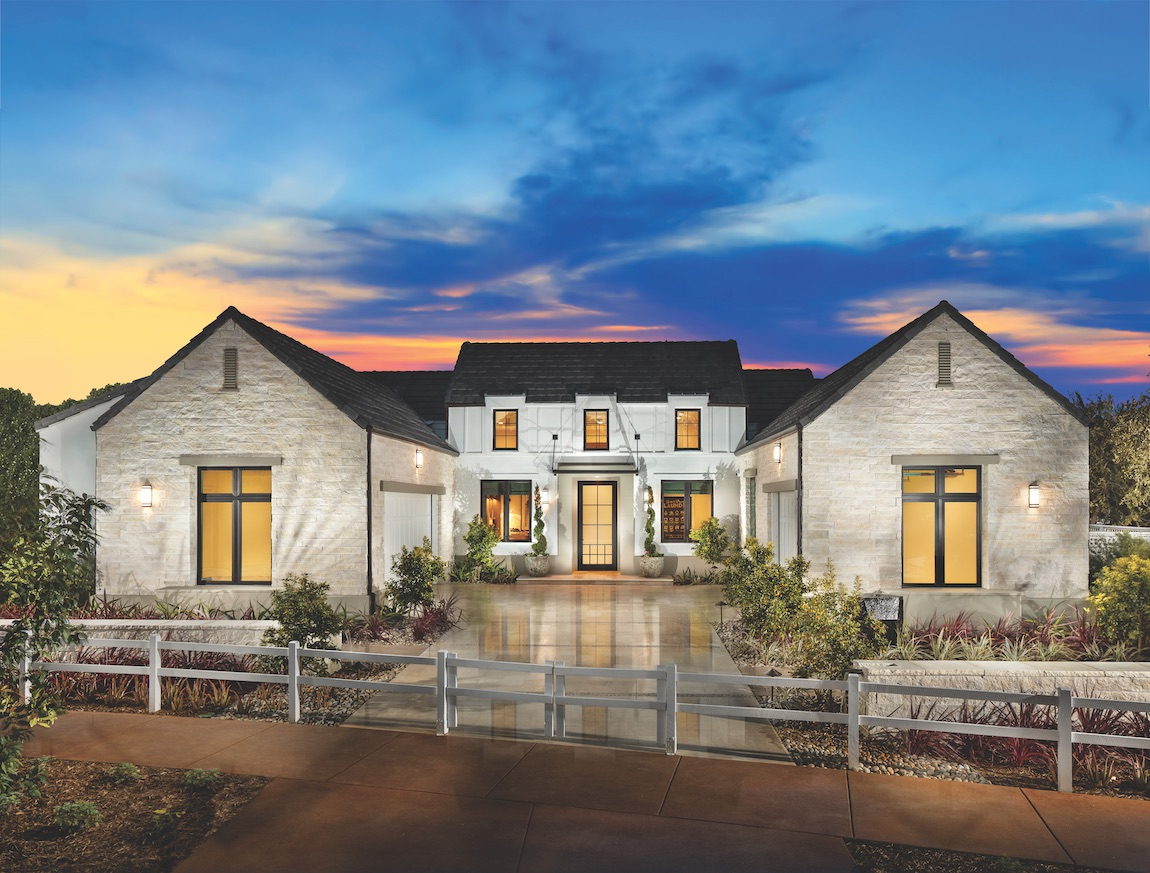 Double garage with white exterior and picket fence.