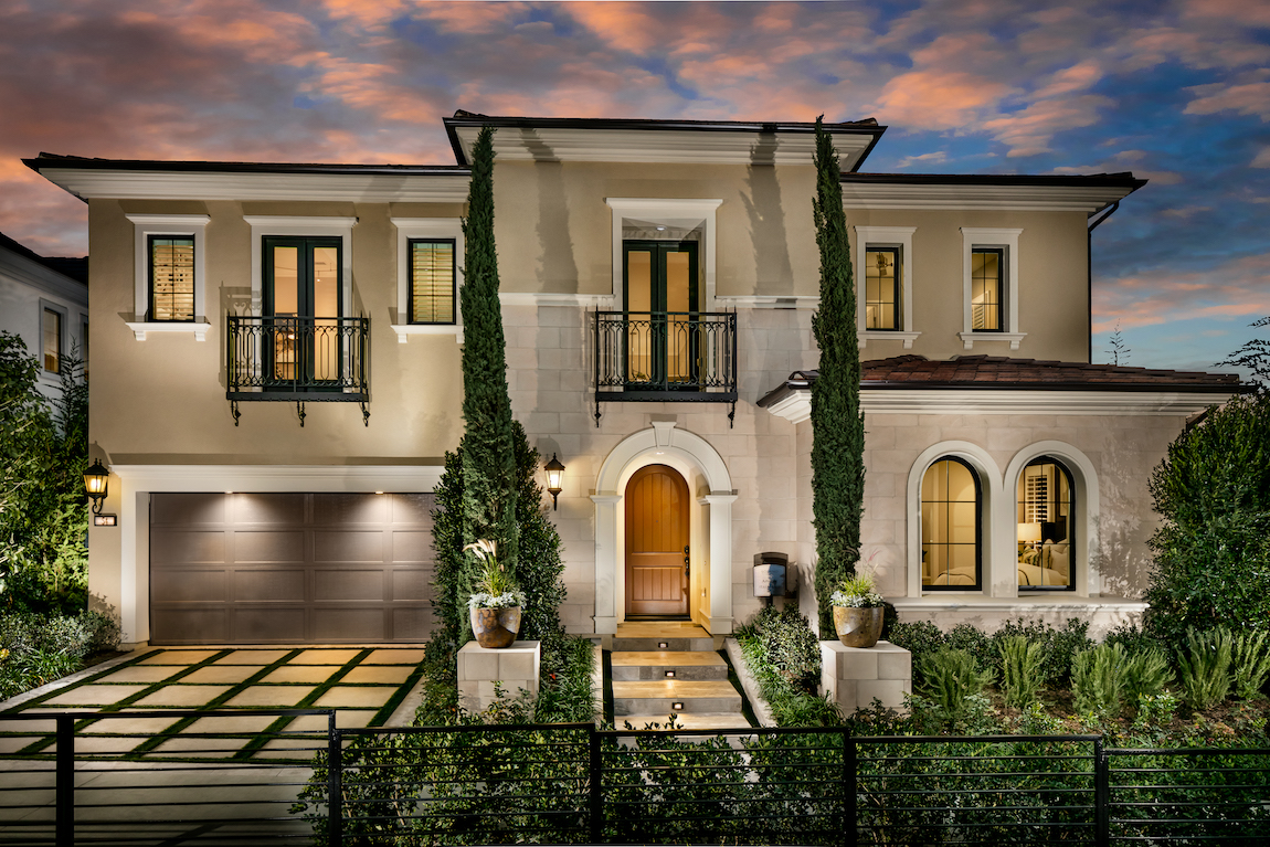 Home with extensive landscaping and elaborate pathway to front door.