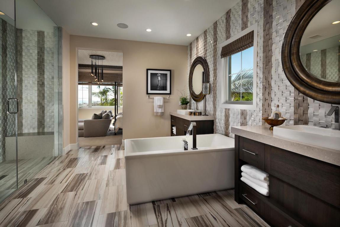 Bathroom with accent walls and freestanding tub.