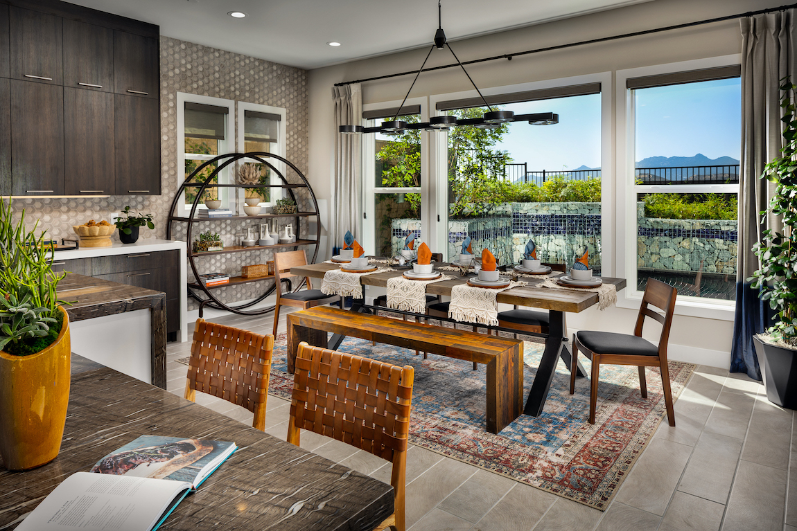 Dining space in kitchen with view and boho chic carpet.
