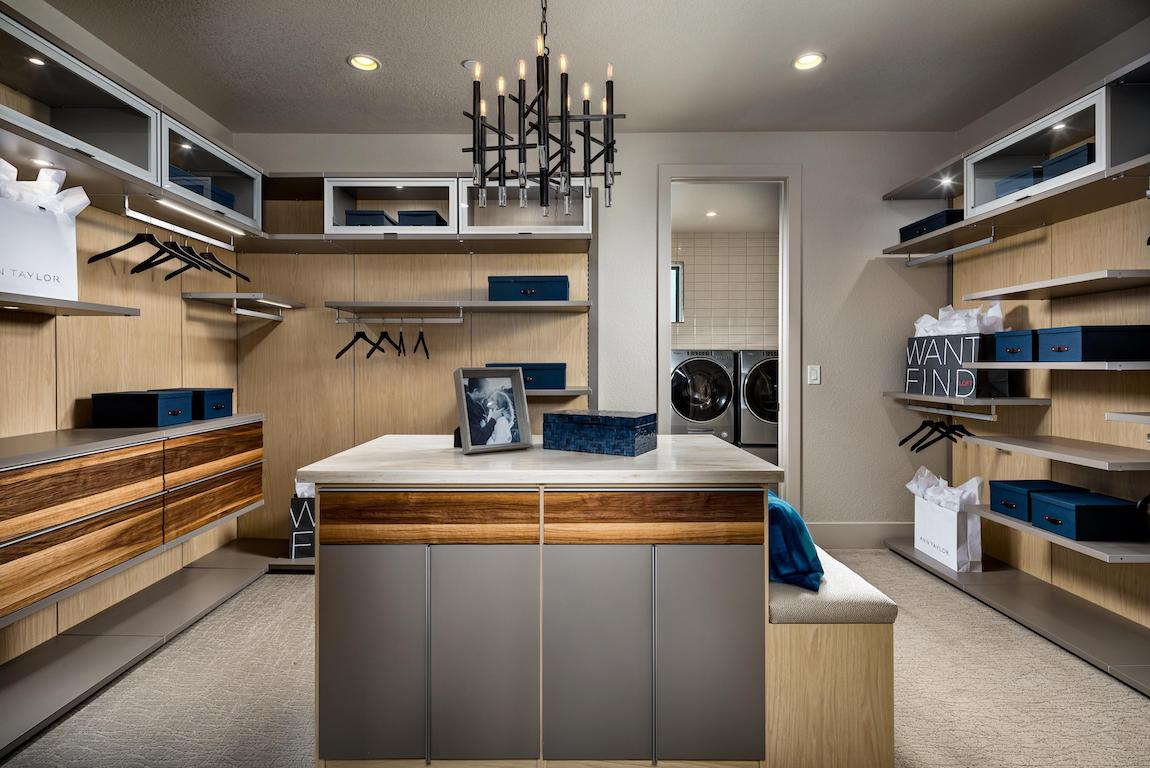 Luxe walk-in closet with plenty of added storage space.