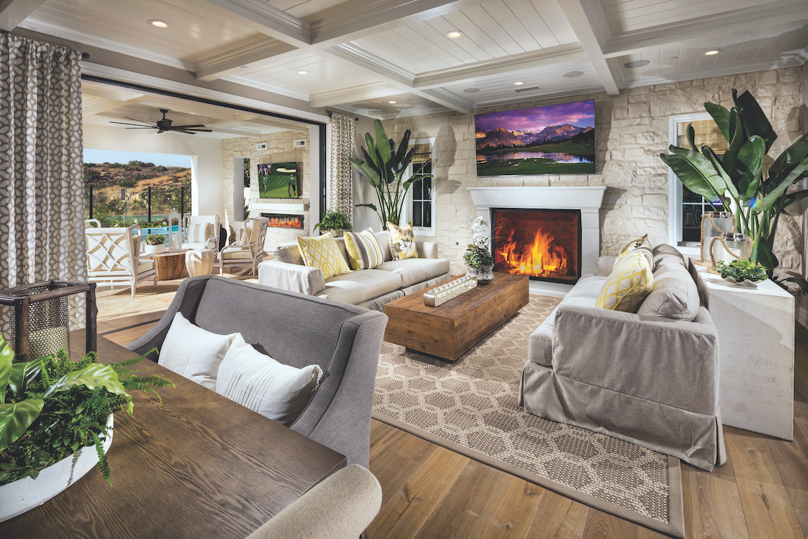 Living room with fireplace and wooden floor.