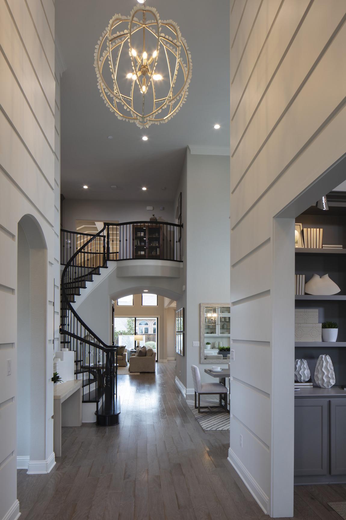 Decorative caged chandelier in foyer