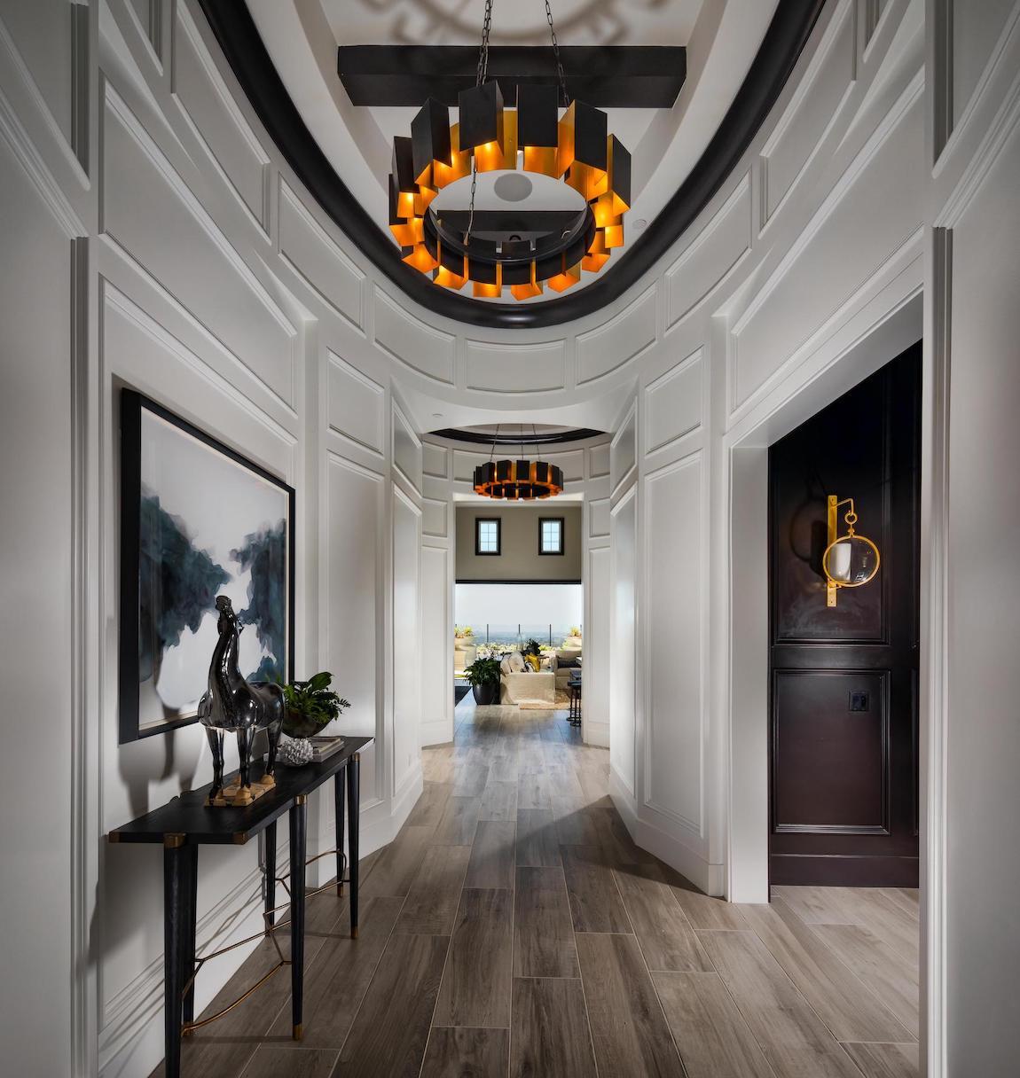 Modern metallic pendant lighting in entryway