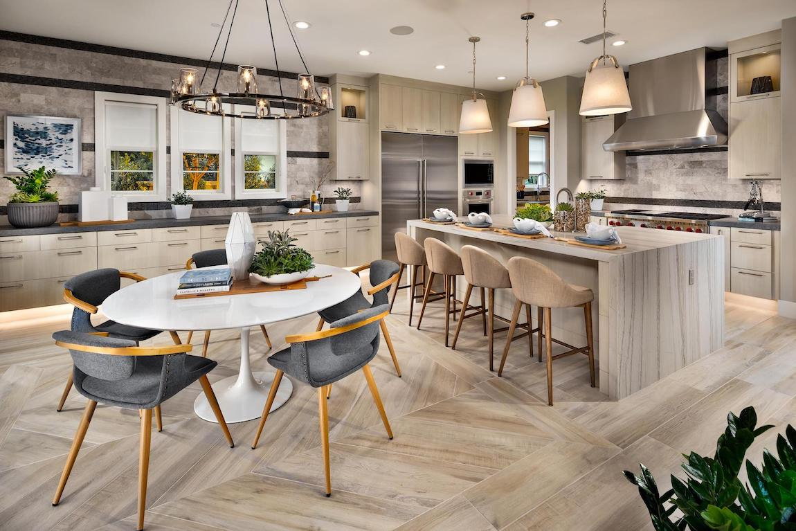 Modern chandelier and shaded pendant lighting in modern kitchen