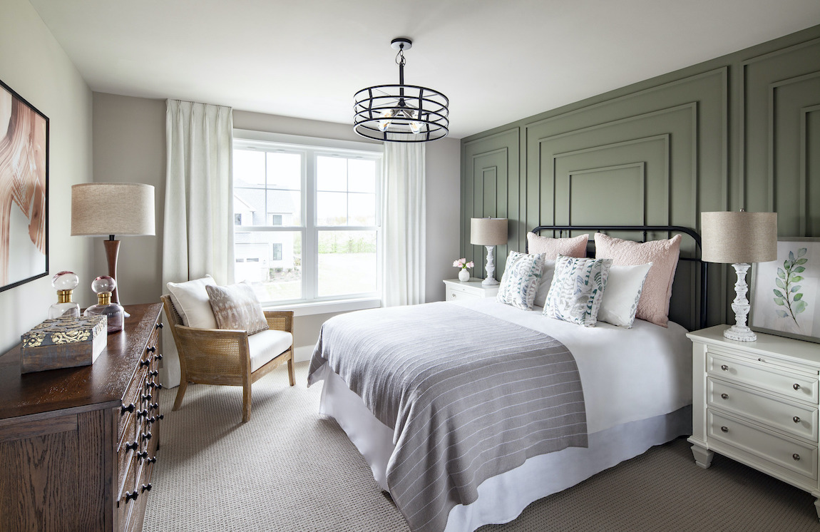 Bedroom with beveled green accent wall.