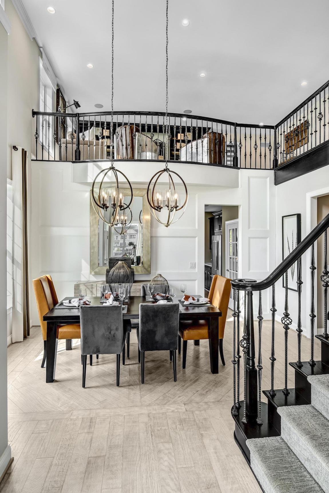 Matching metal caged chandeliers in the dining room