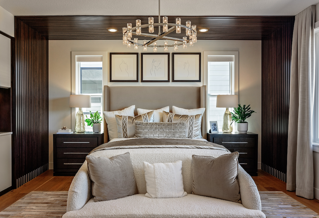 Bedroom with dark wood bedroom trim that extends from wall to ceiling