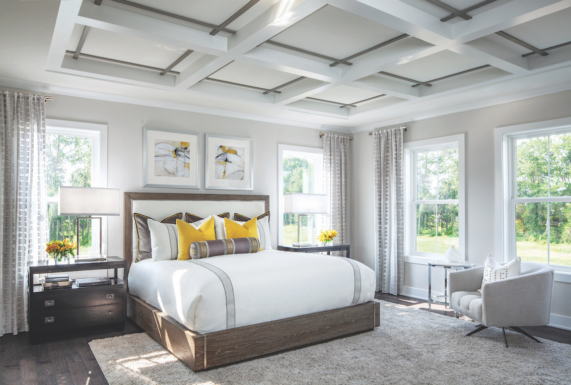 Master bedroom highlighted by yellow accents and wood undertones