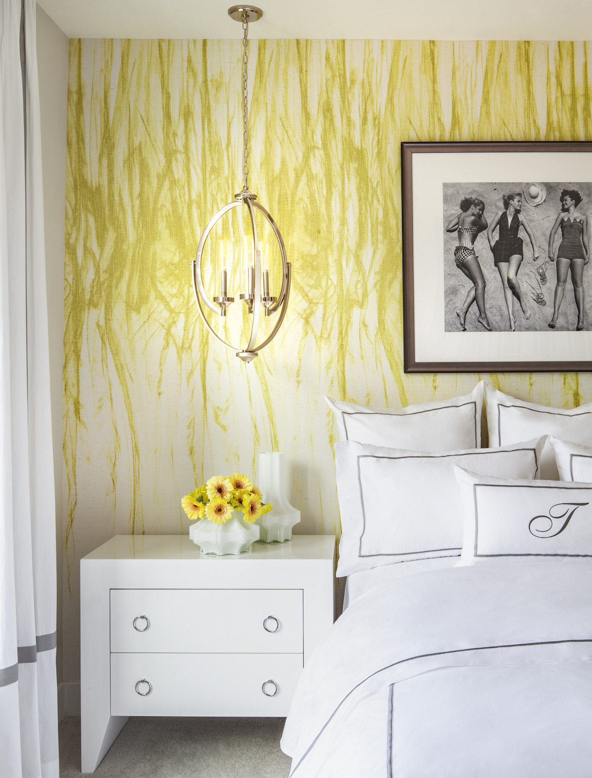 Bedroom featuring bold yellow walls and flowers that accentuate color scheme