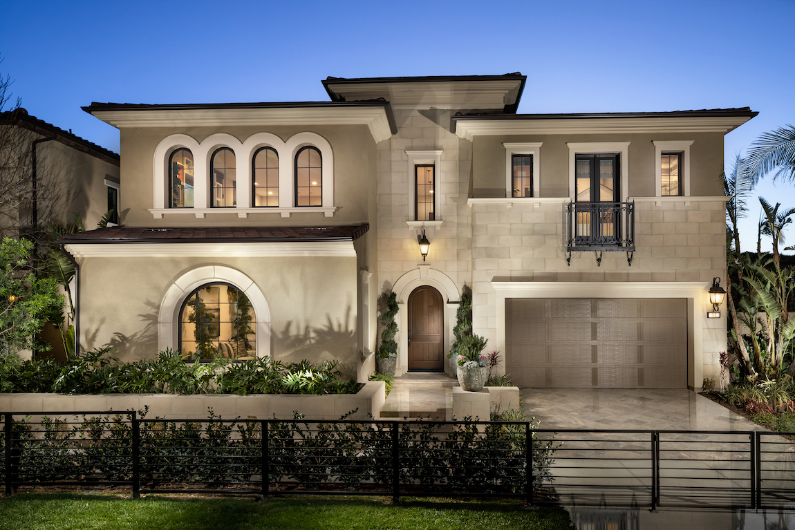 Home with curved windows and stone exterior with castle-type features.