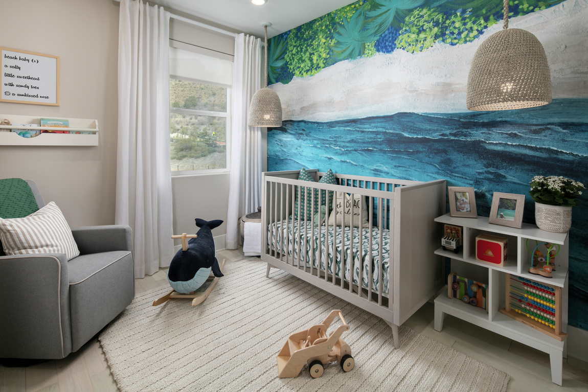 Nursery with colorful wallpaper, crib and neutral tones