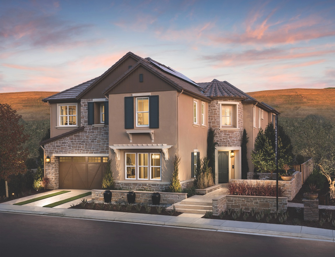 Home with stone and stucco mix with Terracatto tile roof.