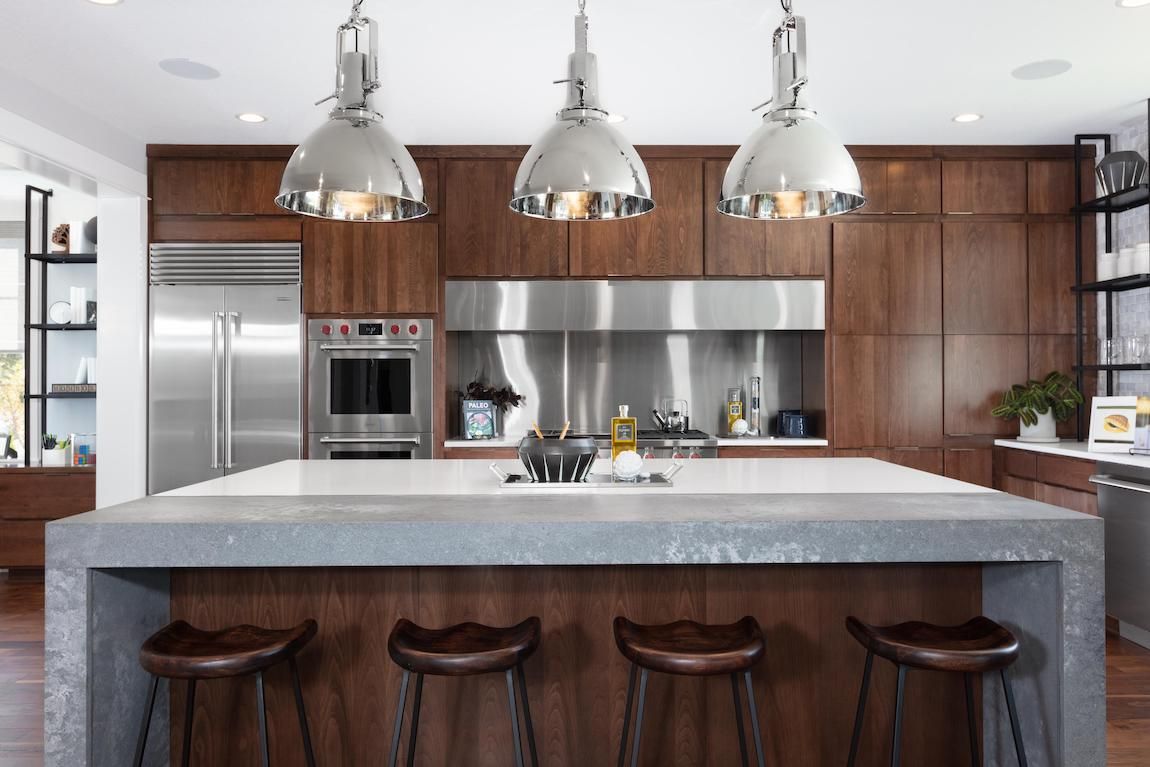 Luxury kitchen with modern home technology such as a smart fridge and cooktops.