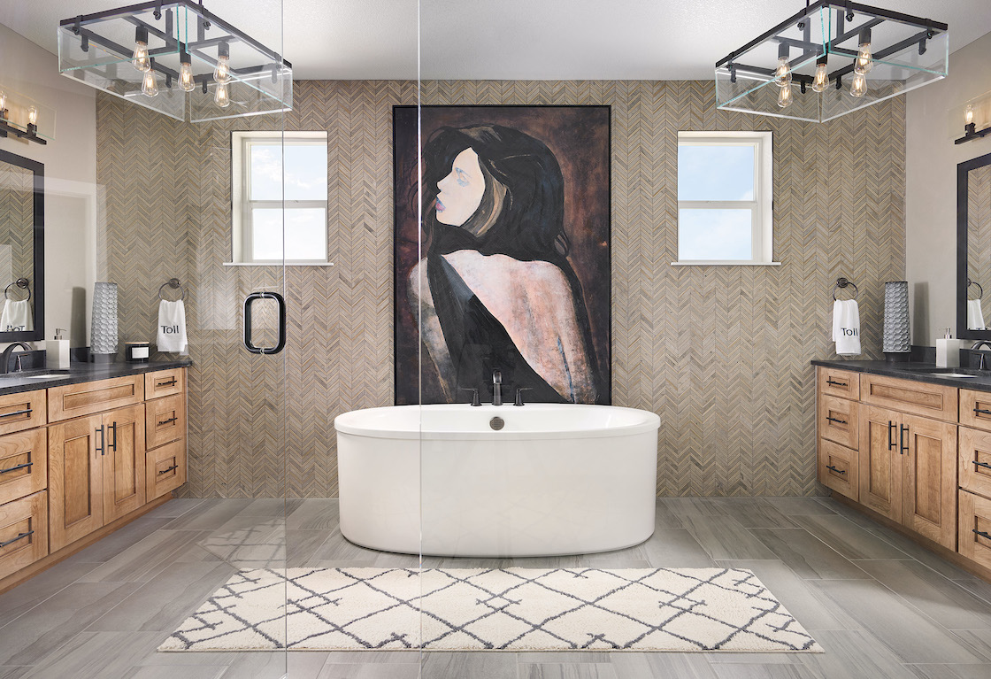 Bathroom with tile accent and mural with freestanding tub