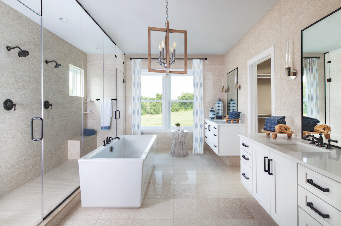 Master bath highlighted by elegant lighting fixture