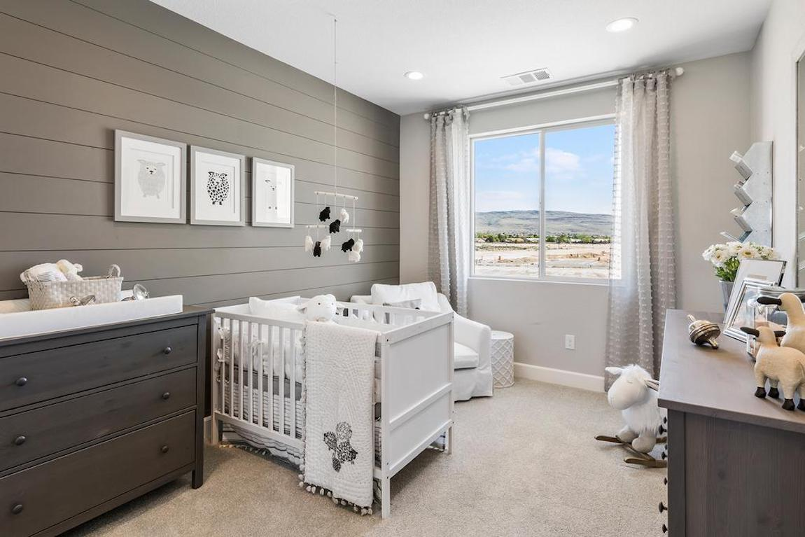 Nursery with gray statement wall.