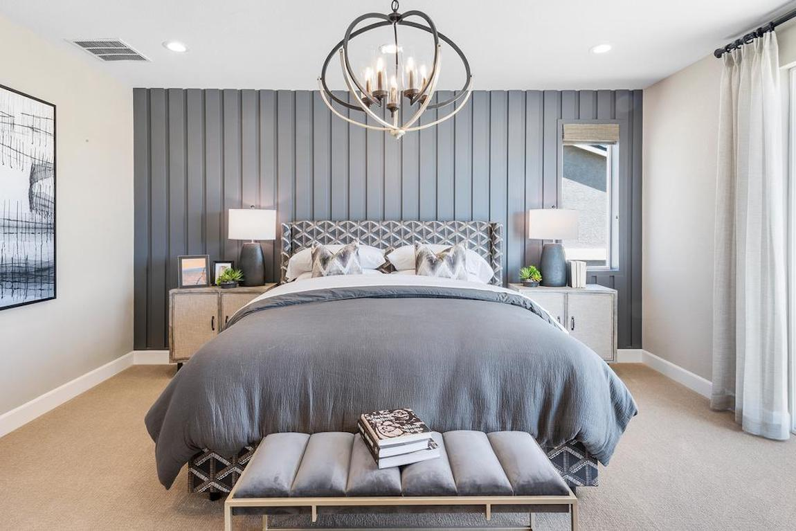 Blue and gray bedroom with wooden plank accent wall design.
