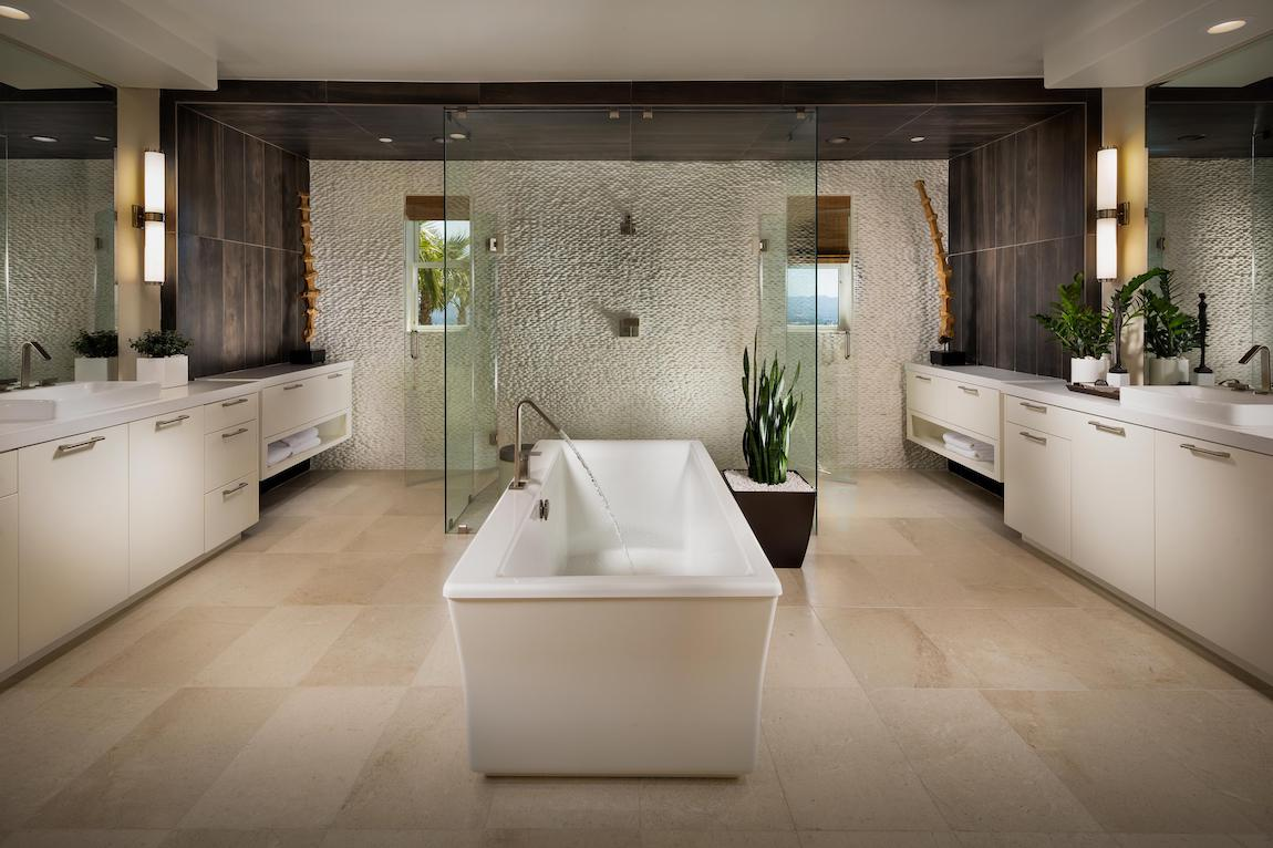 Luxurious master bathroom featuring focal freestanding tub and dramatic walk-in shower.