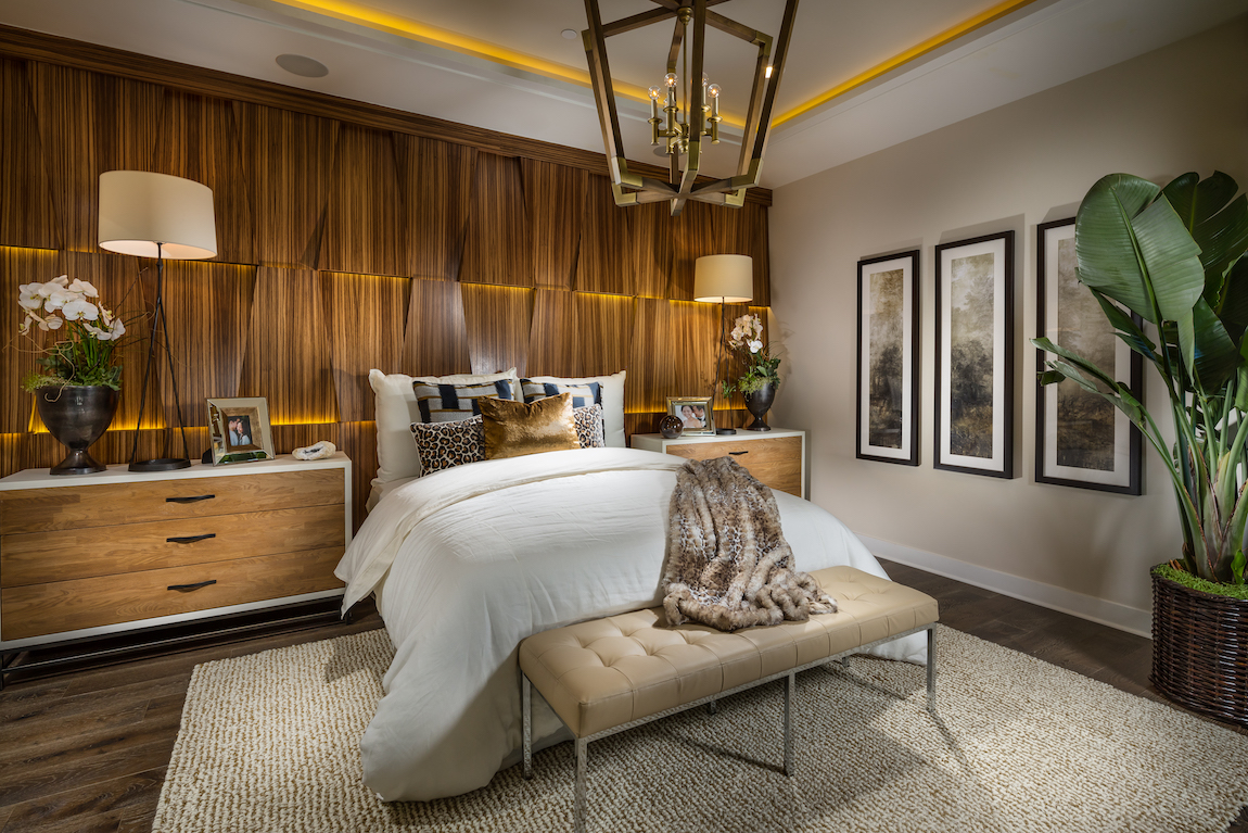 Luxe bedroom with accent lighting, accent wall, and interior plants
