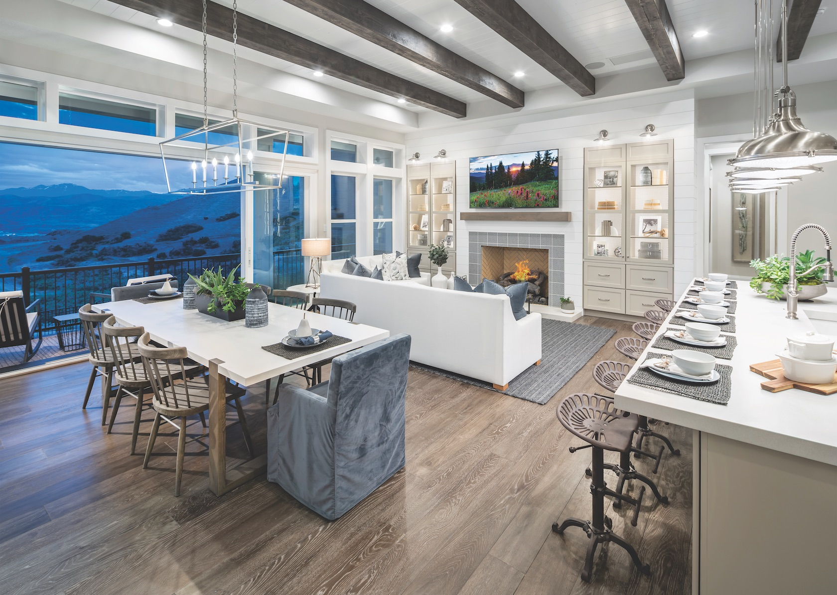 Utah home with great room with mountain view, kitchen, and beamed ceilings.