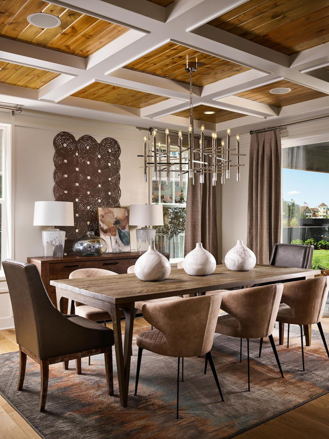 Striking dining room design featuring coffered ceiling