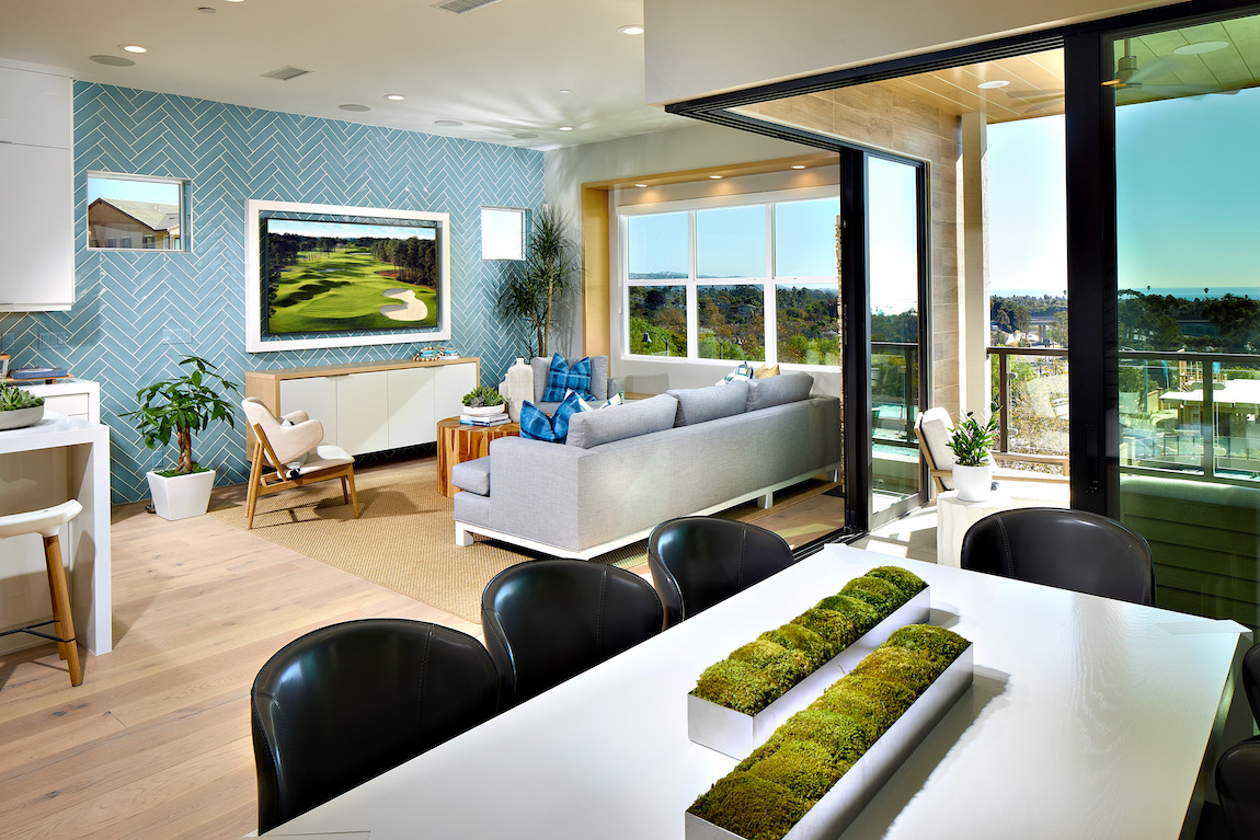Gorgeous living room highlighted by vibrant colors and natural elements