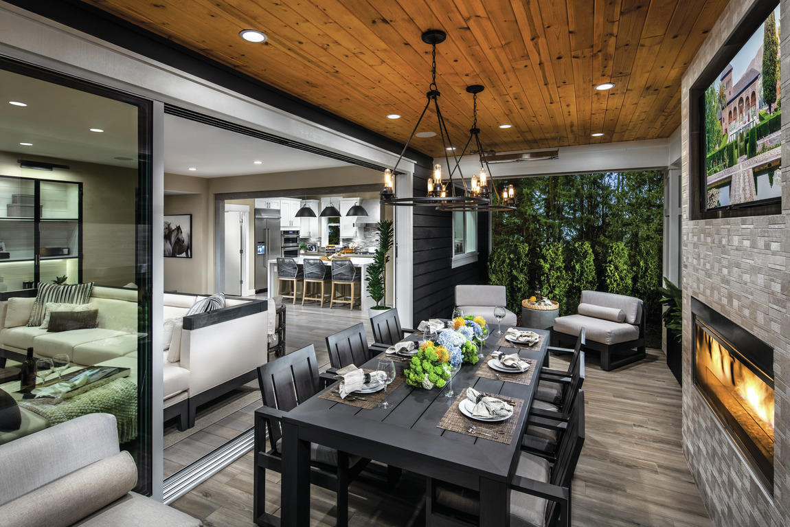Indoor-Outdoor living featuring outdoor dining space
