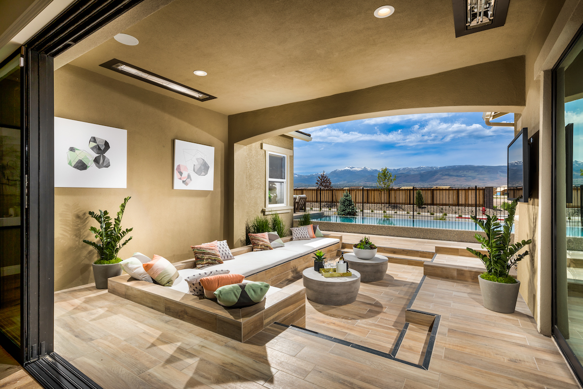 A patio in a luxury Toll Brothers home in Nevada overlooking mountains.