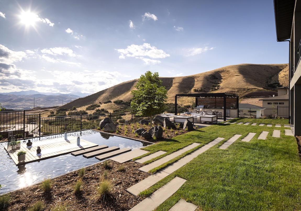 Backyard and pool with a mountain view in a Toll Brothers model home in Canyon Point at Traverse Mountain community.