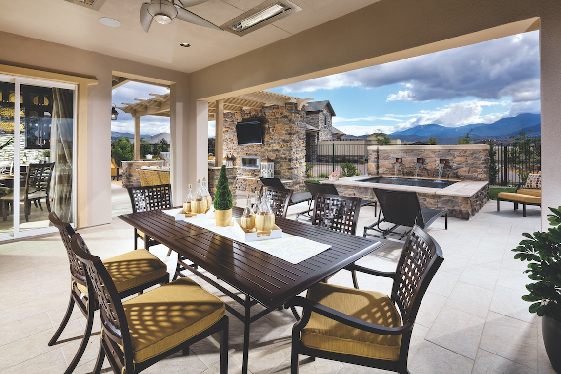 Outdoor living space in a Toll Brothers model home with a view of mountains in Nevada.