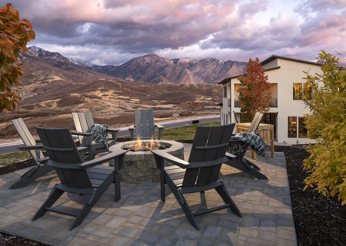 Fire pit in the backyard of a Toll Brothers model home with mountain views at Toll Brothers at Edelweiss in Utah.