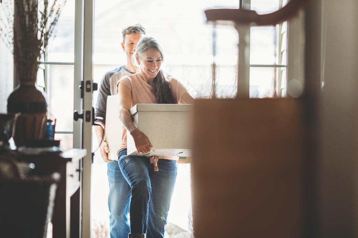 Couple moving into new home with boxes