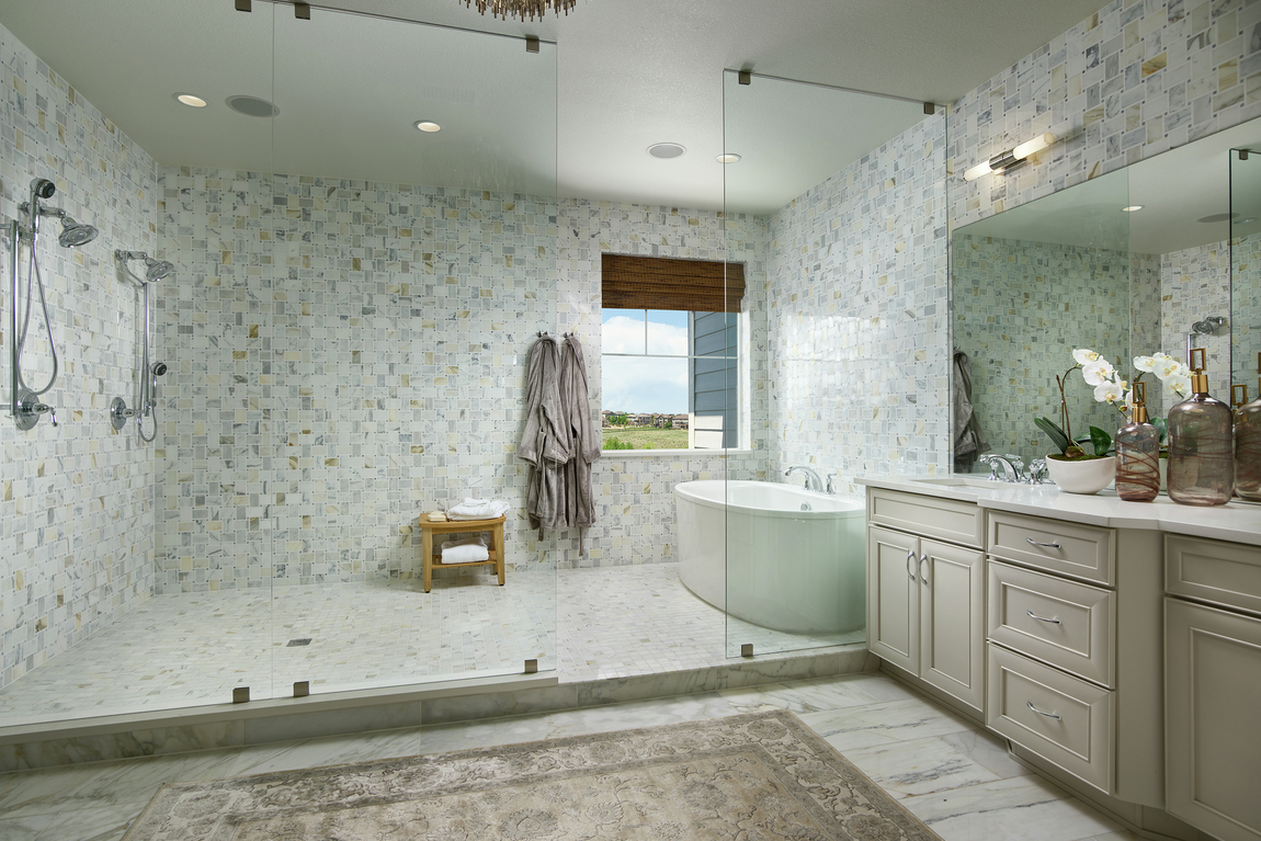 Master bathroom with pleasing, warm tile design