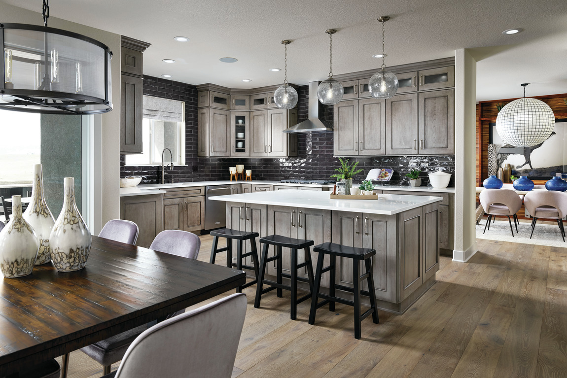 Modern kitchen with industrial decor and black subway tile design.