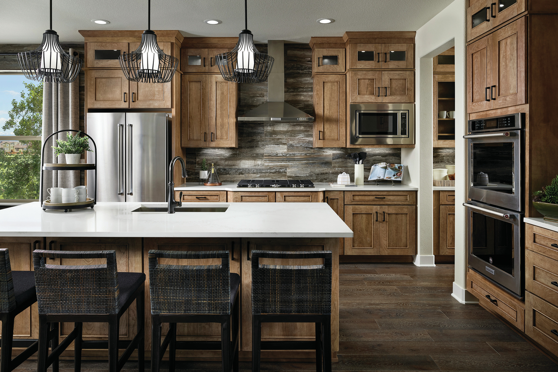 Deluxe kitchen which ample cabinetry and stunning backsplash texture