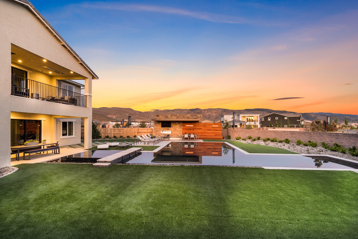 Toll Brothers model home in Nevada overlooking mountains during sunset.