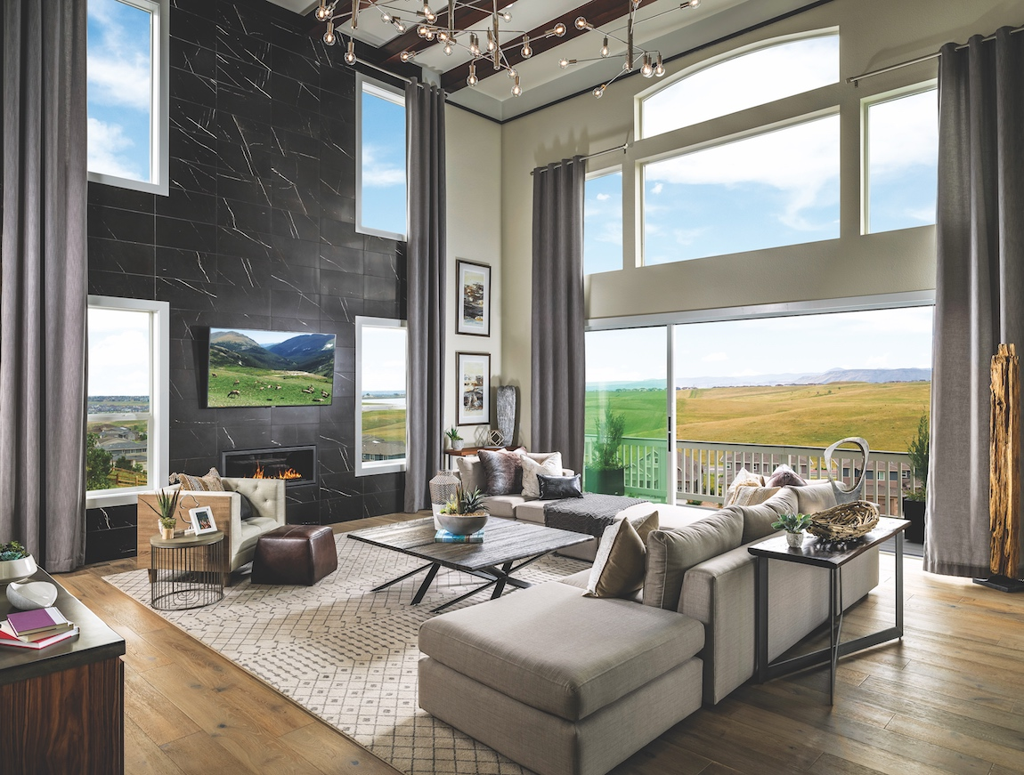 Toll Brothers model home in Toll Brothers at Candelas in Colorado with views of surrounding nature.