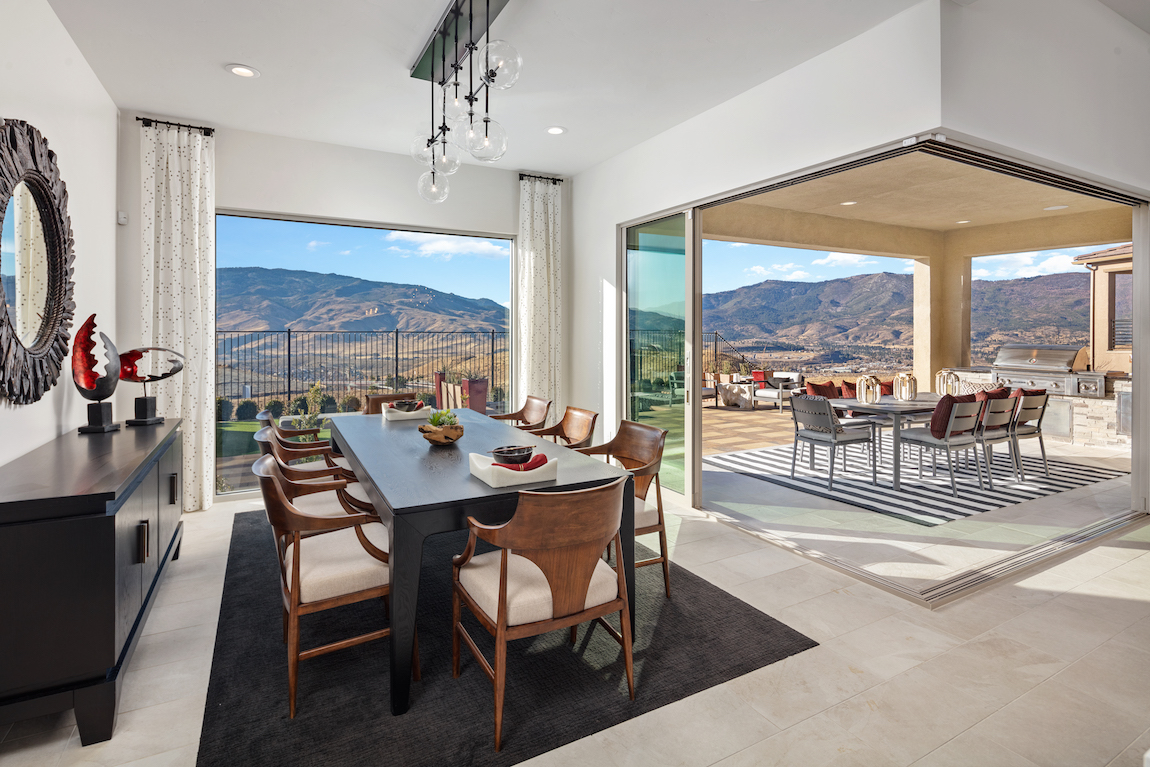 Outdoor living space in a luxury Toll Brothers home overlooking Nevada mountains.