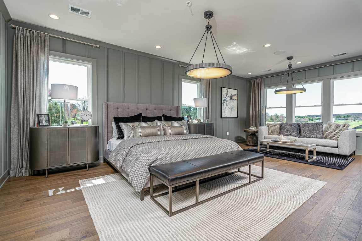 Gray master bedroom with lounge area