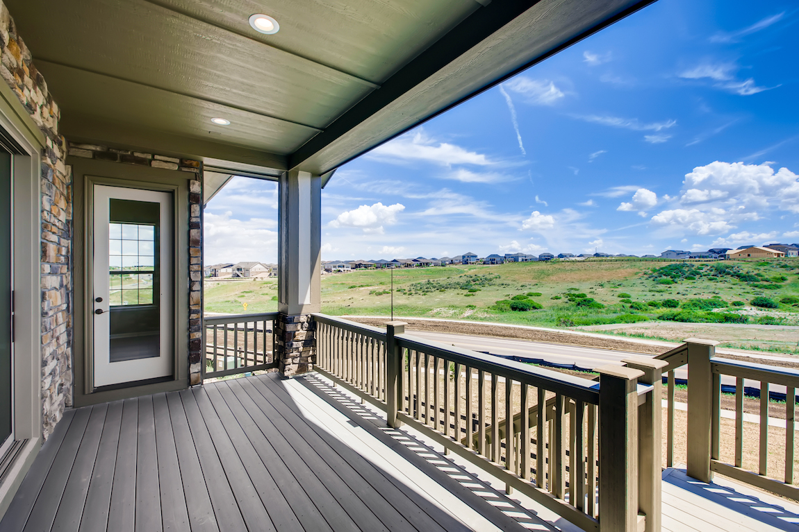 View of open space from a patio in Toll Brothers at Inspiration community.