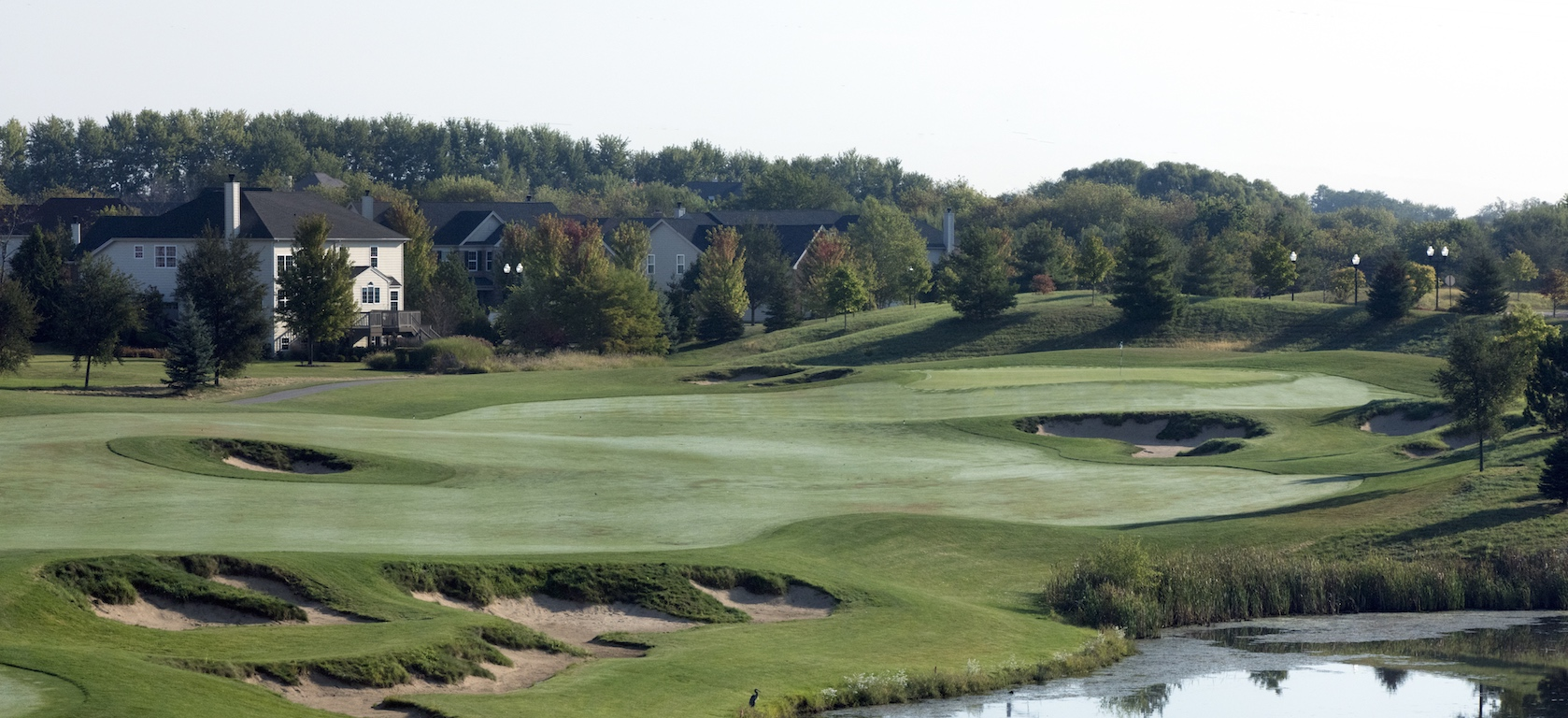 View of golf course and homes in Bowes Creek Country Club Toll Brothers community.